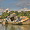 Fishing Boat relic on the Fraser River, Richmond BC. Shot taken at mid tide. Different Saturation on this shot to highlight the partial sun.