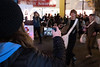 Vancouver Island, Victoria - Woman holding mobile phone taking picture of Newsies dance troupe in Christmas parade