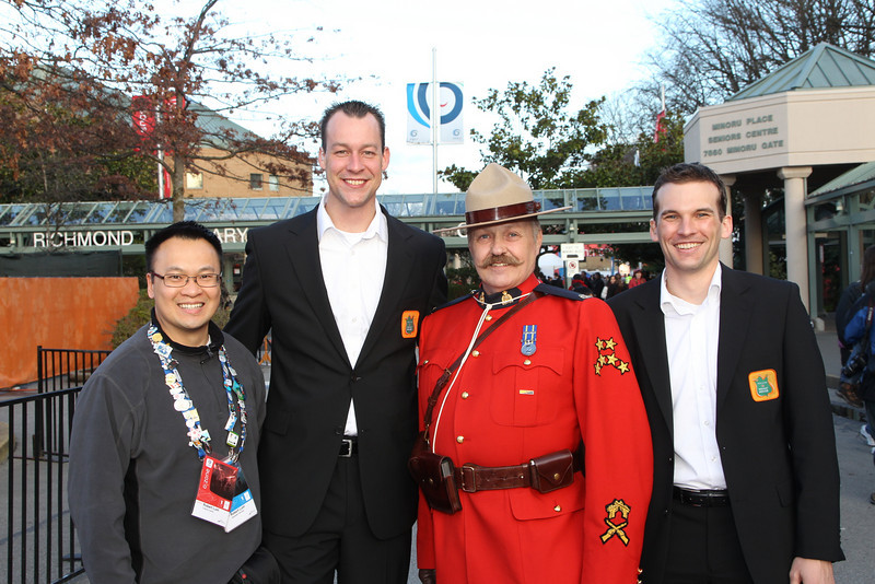 Scenes from the Vancouver 2010 Winter Olympics - Richmond's OZone celebrations<br /> Melbers of the Dutch Delegation, Robert from the Arts Centre, and one of Canada's RCMP members