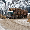 A Logging Tractor Trailer navigates the Snow covered roads of Farwell Canyon, BC, Canada