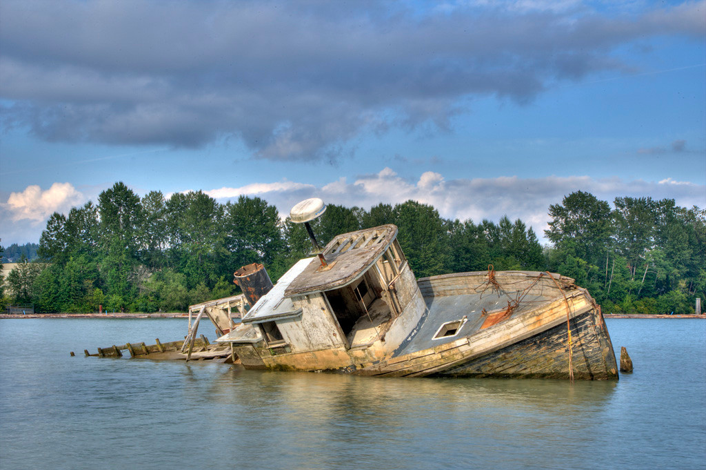 Fishing Boat relic on the Fraser River, Richmond BC. Shot taken at full tide