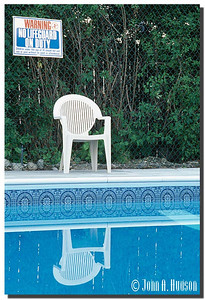 1938_BC-1-0124-NCS-BritishColumbia.jpg : Swimming pool and easy chair at a motel in Kelowna, BC