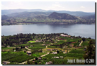 1663_1995011-R4-C3-NCS-BritishColumbia.jpg : Naramata, Okanagan Lake and Summerland, BC on the far shore line, taken from the Kettle Valley rail bed walking trail above Naramata.
