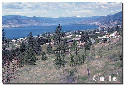 1933_BC-1-0112-NCS-BritishColumbia.jpg : Southern reaches of Naramata, Okanagan Lake and Summerland, BC on the far shore, taken from Kettle Valley rail bed walking trail north of Penticton.