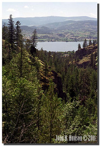 1662_1995011-R3-C4-NCS-BritishColumbia.jpg : Naramata on the nearside lake shore, Okanagan Lake and Summerland on the far lake shore, taken from the Kettle Valley rail bed walking trail between Penticton and Naramata.