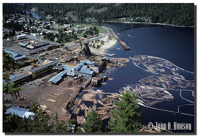 1973_BC-1-0374-NCS-BritishColumbia.jpg : Log mill and Slocan Lake from Highway 6, Slocan, south east British Columbia