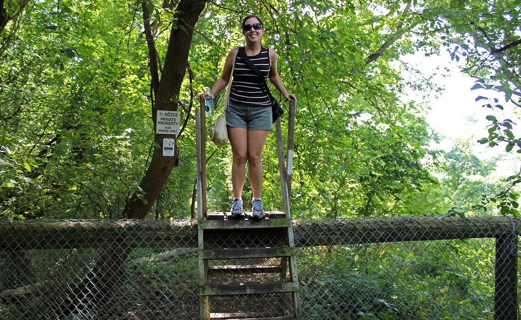 Climbing over a small ladder on the Bruce Trail