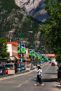 Two Women Crossing The Main Street in Downtown Banff Alberta