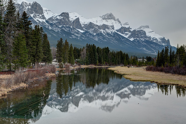 Canmore and mountains in Bow River