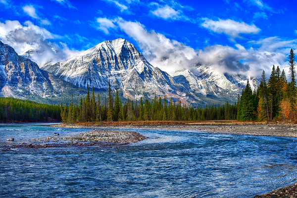 Bow River and snow capped mountains