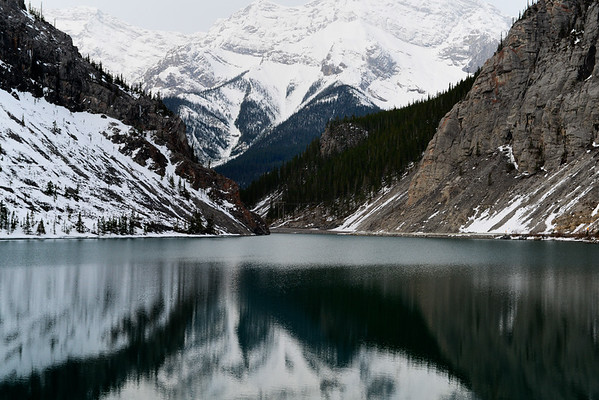 Wonderful reflection of snowy mountains on lake