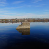 "<a href=""http://nomadicsamuel.com"">http://nomadicsamuel.com</a> : A travel photo of an abandoned train bridge & saturated blue sky along the Saint John River - Fredericton, New Brunswick Canada."