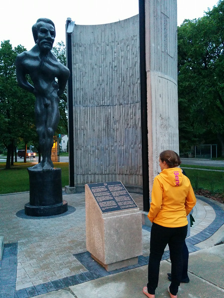 Emilie and Antonia looking a statue of Louis Riel in Winnipeg
