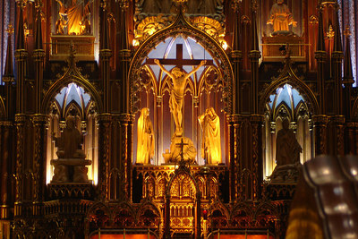 Basilique Notre Dame. The construction of this basillica commenced in 1829.  When erected it was the largest church north of Mexico in North America.  All of the detail work around the altar was erected without the aid of a single nail - Montreal, QC ... October 7, 2006 ... Photo by Rob Page III