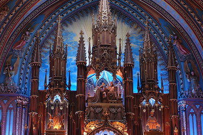 The top of the altar at the Basilique Notre Dame. The construction of this basillica commenced in 1829.  When erected it was the largest church north of Mexico in North America.  All of the detail work around the altar was erected without the aid of a single nail - Montreal, QC ... October 7, 2006 ... Photo by Rob Page III