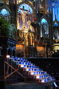 Basilique Notre Dame. Candles down by the main altar - Montreal, QC ... October 7, 2006 ... Photo by Rob Page III