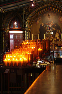 Basilique Notre Dame. Some of the candles and paintings off to the side - Montreal, QC ... October 7, 2006 ... Photo by Rob Page III