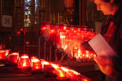 Basilique Notre Dame. Lighting one of the candles off to the side - Montreal, QC ... October 7, 2006 ... Photo by Rob Page III