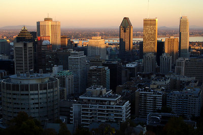 The sun's rays reach over Mont Royal to burn the tops of the city's buildings - Montreal, QC ... October 7, 2006 ... Photo by Rob Page III