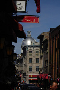 Looking east down Rue Saint Paul with the dome of Marche Bonsecours rising in the background.  This is cobblestone street with a very European feel.  The Market (marche) served as Montreal's central market until supermarkets drove it out of business in the 1960's - Montreal, QC ... October 9, 2006 ... Photo by Rob Page III
