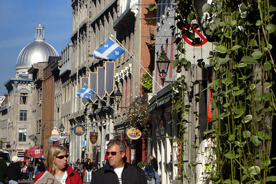 Looking east down Rue Saint Paul with the dome of Marche Bonsecours rising in the background.  This is cobblestone street with a very European feel.  The Market (marche) served as Montreal's central market until supermarkets drove it out of business in the 1960's - Montreal, QC ... October 7, 2006 ... Photo by Rob Page III