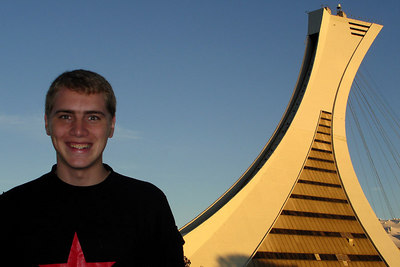 Rob and the Montreal Tower that lords over the Olympic Stadium.  It is the tallest inclined structure in the world at 190 meters - Montreal, QC ... October 8, 2006 ... Photo by Emily Conger