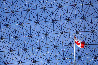 The Canadian flag billows in the wind at the Biosphere - Montreal, QC ... October 8, 2006 ... Photo by Rob Page III