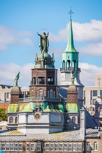 """The Notre-Dame-de-Bon-Secours Chapel is one of the oldest churches in Montreal, built in 1771 over the ruins of an earlier chapel.  St. Marguerite Bourgeoys, the first teacher in the colony of Ville-Marie and the founder of the Congregation of Notre Dame, rallied the colonists to build a chapel in 1655. In 1673, returning from France, Bourgeoys brought a wooden image of Our Lady of Good Help; the stone church was completed in 1678. It burned in 1754, the reliquary and statue being rescued.  In the 19th century, the chapel came to be a pilgrimage site for the sailors who arrived in the Old Port of Montreal; they would make offerings to the Virgin in gratitude for her """"good help"""" for safe sea voyages. In 1849, Mgr. Ignace Bourget, Bishop of Montreal, gave the chapel a statue of the Virgin as Star of the Sea, which was placed atop the church overlooking the harbour. Emphasizing the connection of the chapel and the port, the chapel is often called the Sailors' Church.  The chapel now also houses the Marguerite Bourgeoys Museum, dedicated to the life of St. Marguerite Bourgeoys and to the early history of Montreal and the chapel site. The church's prominent spire can also be climbed, offering views of the Old Port and Saint Lawrence River. In 2005, Marguerite Bourgeoys's mortal remains were brought back to the church, where she now lies in the sanctuary."""