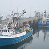 Fishing boats in the mist