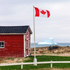 Canadian flag and iceberg at Elliston in Newfoundland