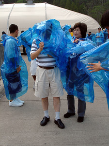 Mama helping Papa put on his Maid of the Mist poncho - Niagara Falls, Canada ... June 12, 2005 ... Photo by Rob Page III