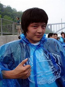 Masashi with his Maid of the Mist poncho.  He is ready to go - Niagara Falls, Canada ... June 12, 2005 ... Photo by Rob Page III