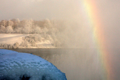 A rainbow emerges from the mist - Niagara Falls, ON ... December 22, 2008 ... Photo by Rob Page III