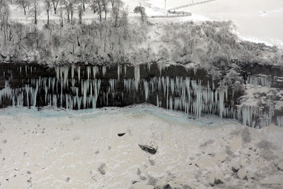 The ice flows out of the walls - Niagara Falls, ON ... December 23, 2008 ... Photo by Rob Page III