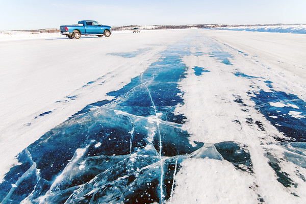 Cars driving on the Dettah Ice Road in Yellowknife