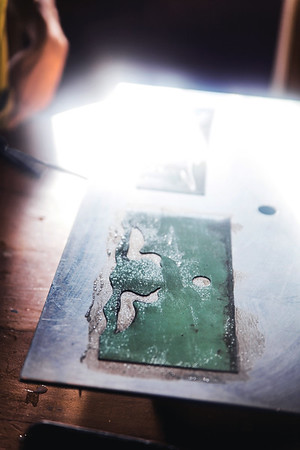 Stencil design at the glass workshop