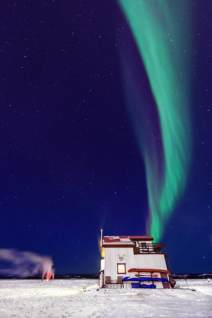 Northern Lights and house boat on Great Slave Lake, Yellowknife