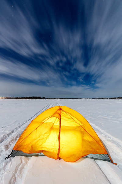Yellowknife, Long Lake - Yellow tent on snowmobile tracks