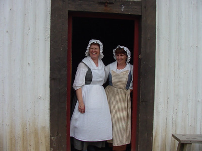 Two ladies in period costume who baked old fasshioned bread for the tourists.