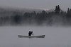 Canoeist on Lake of Two rivers with fog