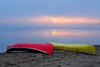 Canoes on beach with sunrise
