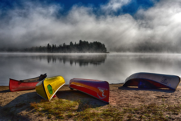 Foggy Lake with Canoes