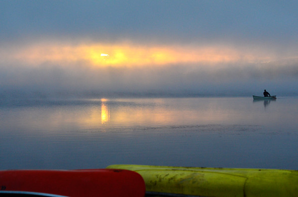 Sun fog and canoeist