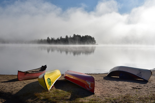 Canoes and fog on Lake of Two Rivers