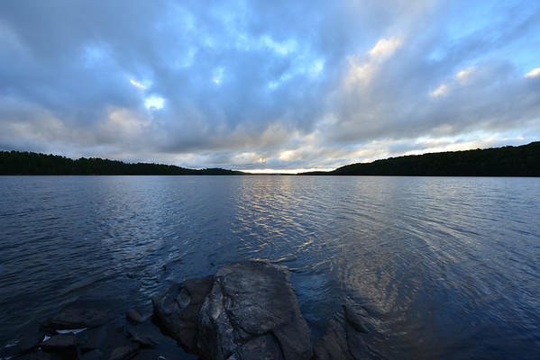 Wide angle and clouds rolling over lake