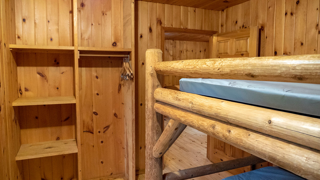 Shelving unit of bunk bed room at the rustic cabin