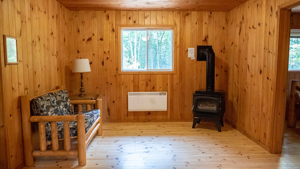 Living room in the rustic cabin at Bonnechere Provincial Park