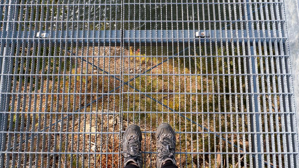 Walking across the suspension bridge, looking down