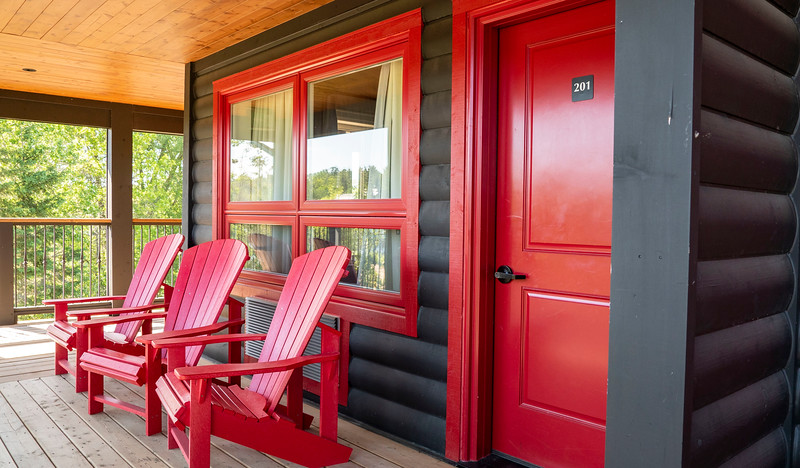 Red Muskoka chairs outside of our room