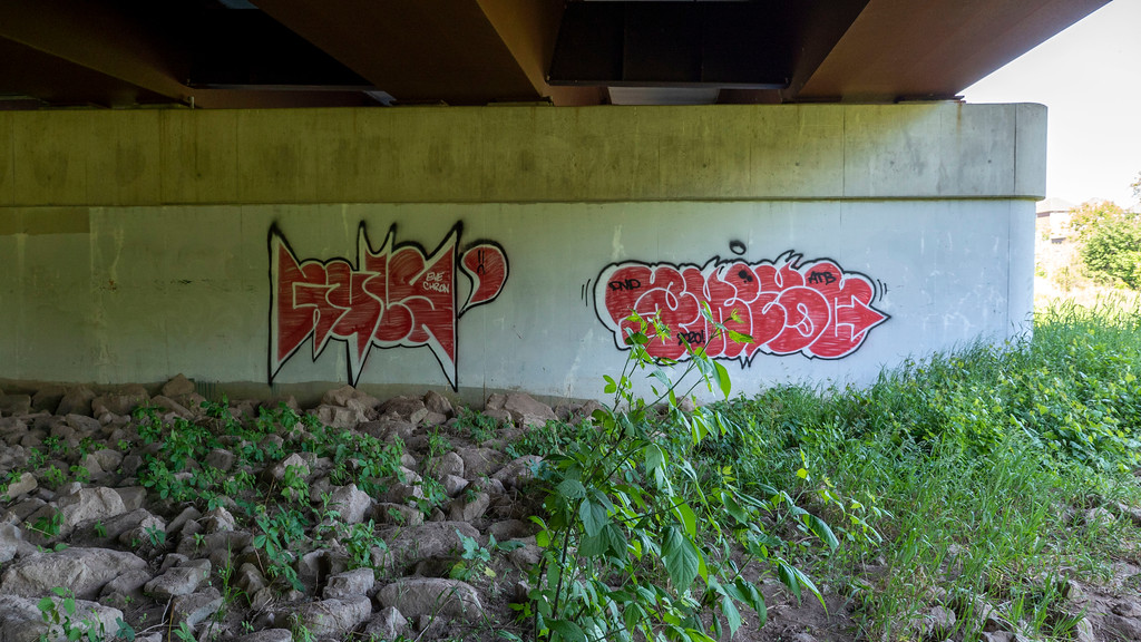 Graffiti and rock piles underneath Derry Road, Mississauga